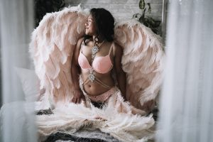 boudoir photography session with angel wings